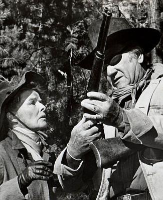 Katharine Hepburn as Eula Goodnight and John Wayne as Rooster Cogburn in Rooster Cogburn (1975)