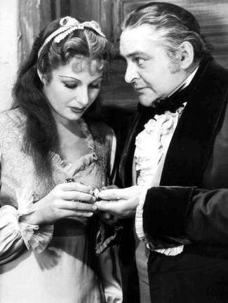 Binnie Barnes as Countess Elizabeth Bartoffski and Edward Arnold as John Sutter in Sutte's Gold (1936)