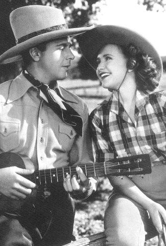 Dick Powell as Elly Jordan and Priscilla Lane as Jane Hardy in Cowboy from Brooklyn (1938)
