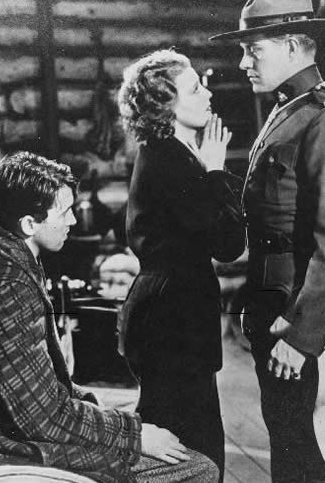 James Stewart as John Flower, Jeanette MacDonald as Maria de Flor and Nelson Eddy as Sgt. Bruce in Rose-Marie (1936)