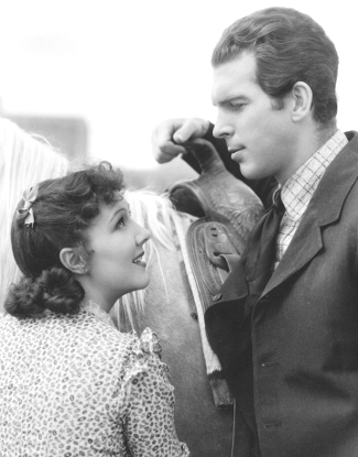 Jean Parker as Amanda Bailey and Fred MacMurray as Jim Hawkins in The Texas Rangers (1936)
