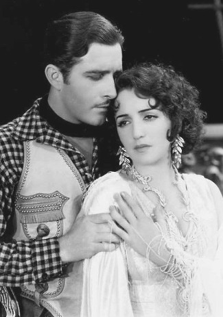 John Boles as Capt. Jim Stewart with Bebe Daniels as Rita Ferguson in Rio Rita (1929)