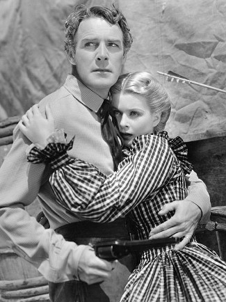 Randolph Scott as Kirk Jordan with Joan Bennett as Ivy Preston in The Texans (1938)