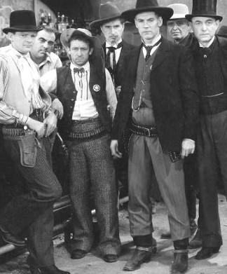 Russell Hopton as Luther Johnson, Raymond Hatton as Deadwood, Walter Huston as Frame Johnson and Harry Carey as Ed Brandt in Law and Order (1932)