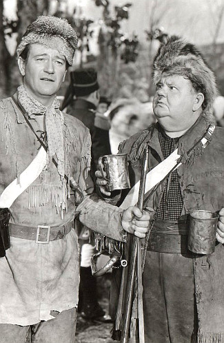 John Wayne as John Breen with Oliver Hardy as Willie Paine in The Fighting Kentuckian (1949)