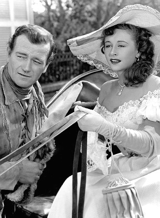John Wayne as John Breen with Vera Ralston as Fleurette De Marchand in The Fighting Kentuckian (1949)