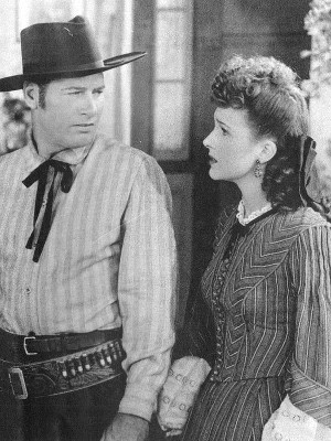 Richard Arlen as Jed Kilton and Lynne Roberts as Judy Parker in The Big Bonanza (1944)