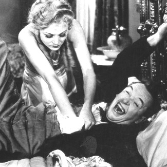 Sharon Lynn as Lola Marcel tries to get the deed from Stan Laurel in Way Out West (1937)