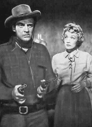Arthur Kennedy as Vern Haskell and Marlene Dietrich as Altar Keane in Rancho Notorious (1952)