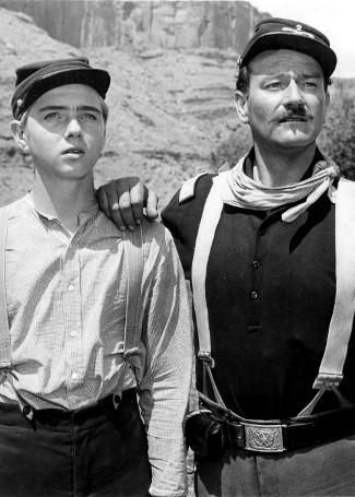 Claude Jarman Jr. as Jefferson Yorke and John Wayne as Lt. Col. Kirby Yorke in Rio Grande (1950)