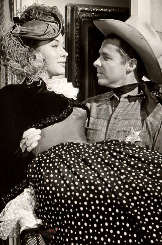 Gia Scala as Tessa Milotte and Audie Murphy as Joe Maybe in Ride a Crooked Trail (1958)