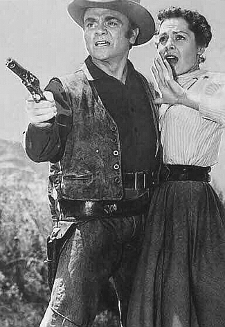 James Cagney as Matt Dow with Viveca Lindfors as Helga Swenson in Run for Cover (1955)