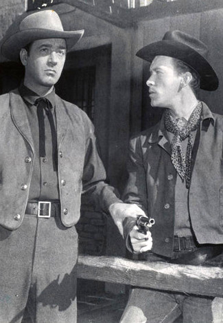 John Payne as Bill Mayhew and Skip Homeier as Sam Mayhew in Road to Denver (1955)