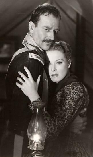 John Wayne at Lt. Col. Kirby Yorke and Maureen O'Hara as Kathleen Yorke in Rio Grande (1950)