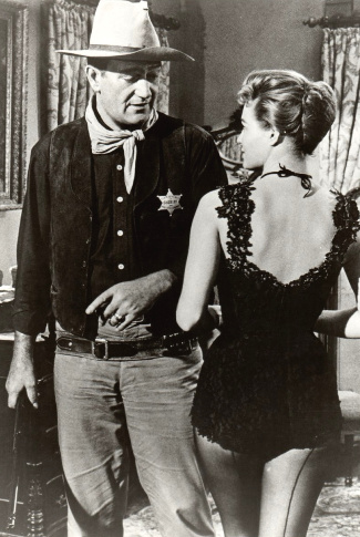 John Wayne as Sheriff John T. Chance with Angie Dickinson as Feathers in Rio Bravo (1959)