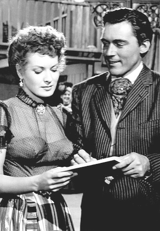 Maureen O'Hara as Kate Maxwell with William Bishop as Jim Averall in The Redhead from Wyoming (1953)