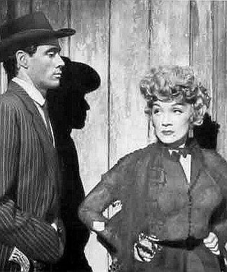 Mel Ferrer as Frenchie Fairmount and Marlene Dietrich as Altar Keane in Rancho Notorious (1952)