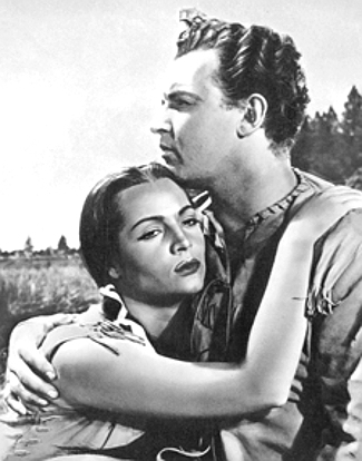 Sara Montiel as Yellow Moccasin with Rod Steiger as O'Meara in Run of the Arrow (1957)
