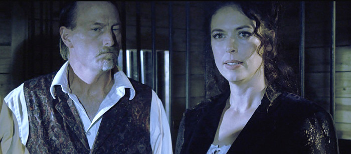 David Moak as Henry Mannors and Amanda Miller as Camille Tammery in Western World (2017)