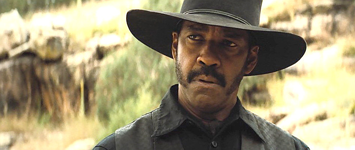 Denzel Washington as Sam Chisholm in The Magnificent Seven (2016)