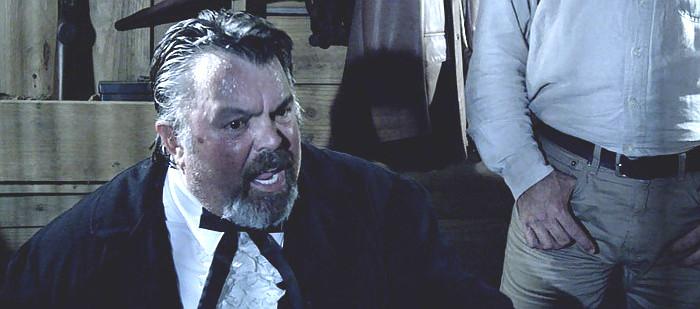 Greg Steele as Mayor Ambrose Taylor in Western World (2017)