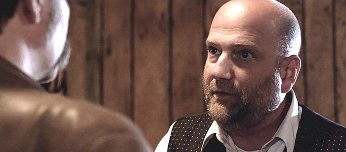 Jason Podplesky as Harlan Pritz in Western World (2017)