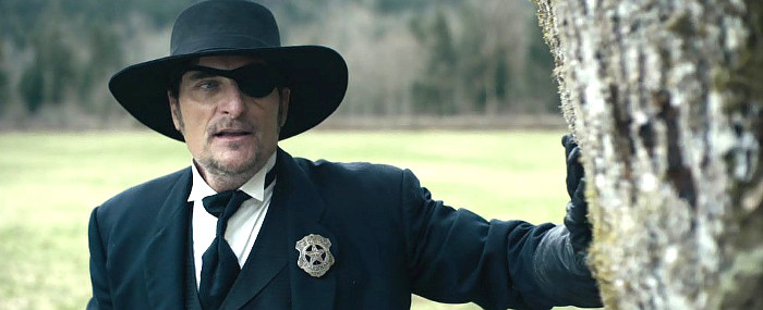 Kim Coates as U.S. Marshal Woody Calhoun in Stagecoach (2016)