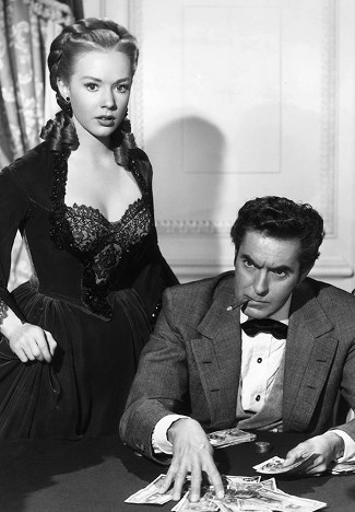 Piper Laurie as Angelique Dureau and Tyrone Power as Mark Fallon in Mississippi Gambler (1953)