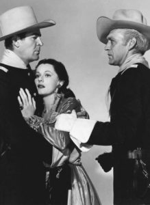 Rod Cameron as Capt. Calhoun, Lorna Gray (Adrian Booth) as Lia Wilson and Forrest Tucker as Col. Unger in Oh Susanna (1951)