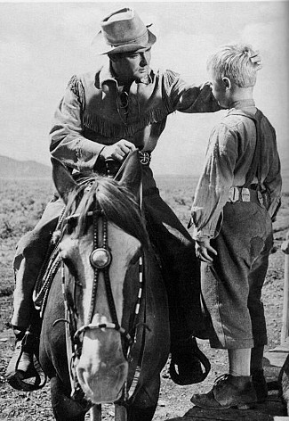 Alan Ladd as Shane with Brandon De Wilde as Joey Starrett in Shane (1953)