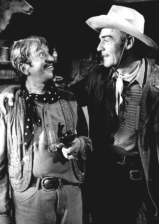 Alfonso Bedoya as Degas and Randolph Scott as Jeff Travis in The Stranger Wore a Gun (1953)