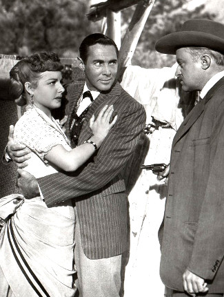 Ann Sheridan as Vermillion O'Toole, Phillip Reed as Newton Cole and Larry Gates as Marshal Ed Daggett in Take Me to Town (1953)