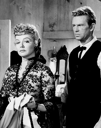 Ann Sheridan as Vermillion O'Toole and Sterling Hayden as Will Hall in Take Me to Town (1953)