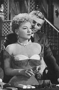 Anne Baxter as Cherry Malotte with Jeff Chandler as Roy Glennister in The Spoilers (1956)