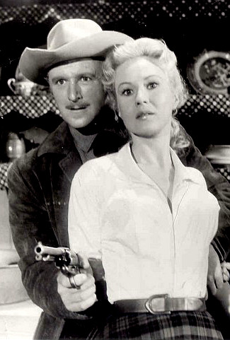 George N. Neise as Mort Harper with Virginia Mayo as Ellen in The Tall Stranger (1957)