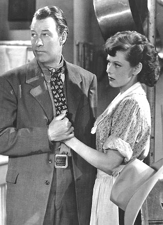 Bill Elliott as Ringo with Lorna Gray (Adrian Booth) as Livvy Weston in The Savage Horde (1950)