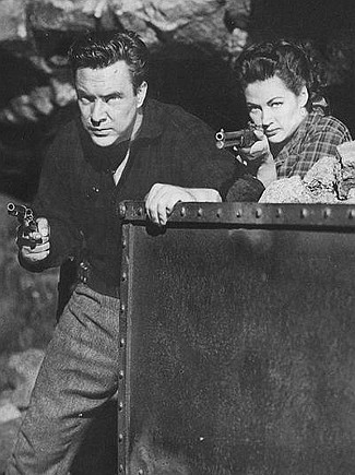 Edmund O'Brien as Larkin Moffatt and Yvonne DeCarlo as Candace Surrency in Silver City (1951)