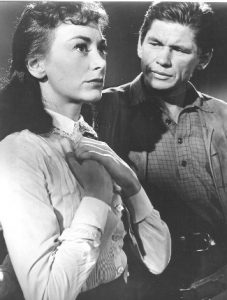 Fintan Meyler as Sally Crane with Charles Bronson as Luke Welch in Showdown at Boot Hill (1958)