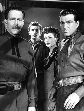Hugh Marlowe as Col. Morsby, Hugh O'Brien as Hatcher, Julie Adams as Valerie Kendrick and Stephen McNally as Lane Dakota in The Stand at Apache River (1953)