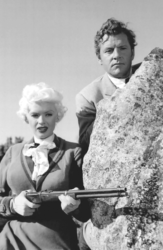 Jayne Mansfield as Kate and Kenneth Moore as Jonathan Tibbs in The Sheriff of Fractured Jaw (1958)