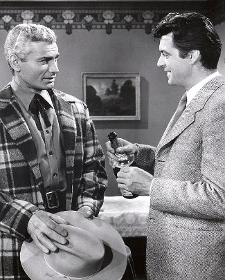 Jeff Chandler as Roy Glennister with Rory Calhoun as Alex McNamara in The Spoilers (1956)