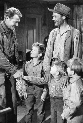 Joel McCrea as Chuck Conner with John Ridgely as Slim Stevens and three of his sons in Saddle Tramp (1950)