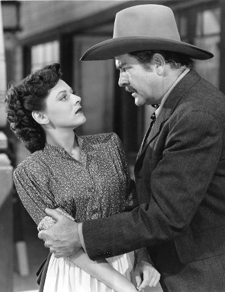 Lorna Gray (Adrian Booth) as Livvy Weston and Grant Withers as Wade Proctor in The Savage Horde (1950)