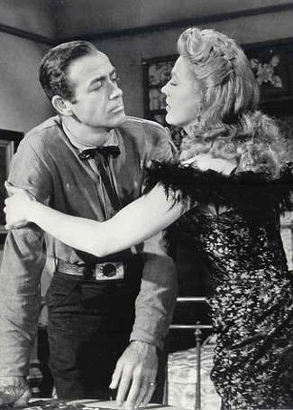 Mark Stevens as Chip Coburn with Gale Robbins as Lou Crenshaw in Gunsmoke in Tucson (1958)