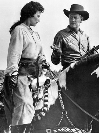 Miroslava as Amy Lee Bannerman and Joel McCrea as Judge Rick Thorne in Stranger on Horseback (1955)