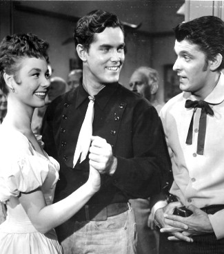 Mitzi Gaynor as Rusty Blair, Jeffrey Hunter as Johnny Colt and Keefe Brasselle as Tony Ballew in Three Young Texans (1954)