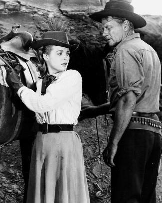 Nancy Gates as Caroline Webb and Joel McCrea as Judge Rick Thorne in Stranger on Horseback (1955)