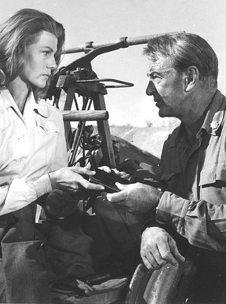Rita Hayworth as Adelaide Geary and Gary Cooper as Maj. Thomas Thorn in They Came to Cordura (1959)