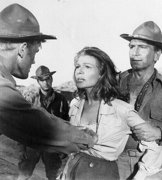 Tab Hunter as Lt. William Fowler, Rita Hayworth as Adelaide Geary and Richard Conte as Cpl. Milo Trubee in They Came to Cordura (1959)
