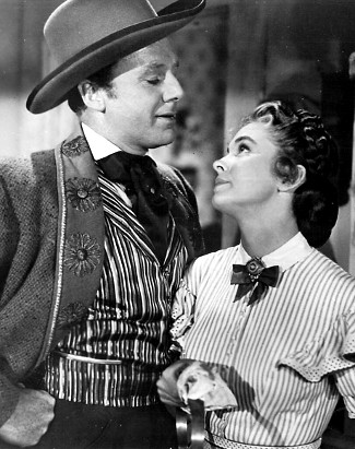 Van Johnson as Capt. James Farraday and Joanne Dru as Nora Curtis in The Siege at Red River (1954)